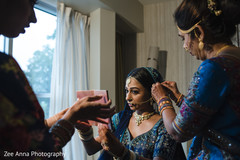 Indian bride getting her nose ring on.