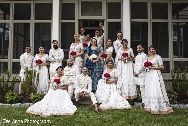 Indian bride, bridesmaids and groomsmen outdoors capture.