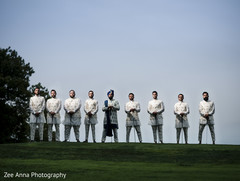 Graceful indian groom with groomsmen photo session.