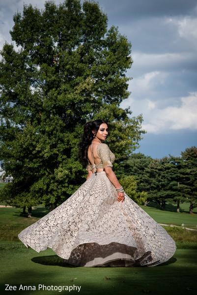 Enchanting indian bride's outdoors portrait.