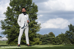 Elegant indian groom outdoors portrait.