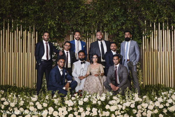 Dazzling indian couple with groomsmen portrait.