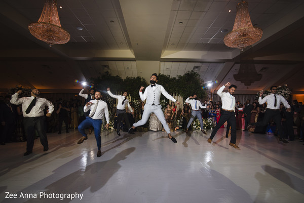 Joyful indian groom with groomsmen showing some dance moves.