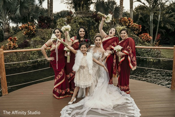 Fun capture of Indian bride with bridesmaids.
