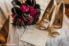 elegant Indian bridal wedding shoes. bouquet, Invitation and jewelry.