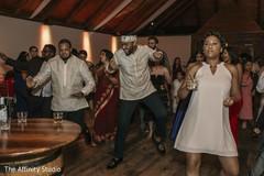 Upbeat Indian wedding reception dance capture.