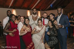 Lovely Indian couple with guests reception capture.