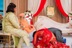 Special Indian bride and groom ceremony moment.