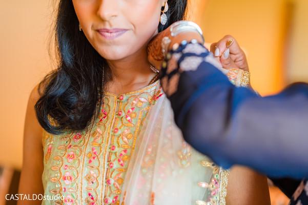 Indian bride getting her lehenga sari on.