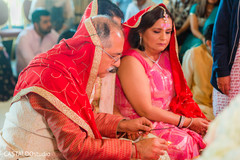 Indian groom's parents at ceremony ritual.