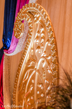 Golden sangeet stage decoration.