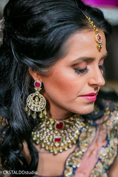 Indian bride on her sangeet kundan set.