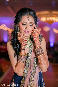 Indian bride wearing her sangeet jewelry.