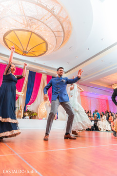Upbeat Indian Sangeet guests dance.
