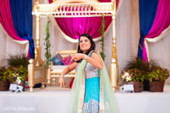Indian bridesmaid at a special sangeet presentation.