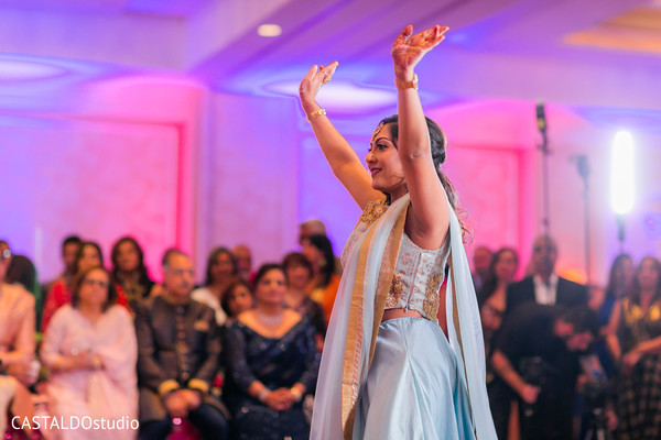 Indian bridesmaid at sangeet dance.