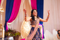 Marvelous Indian bride dancing at sangeet celebration.