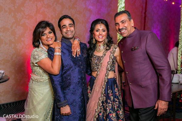 Marvelous portrait of Indian couple with guests.