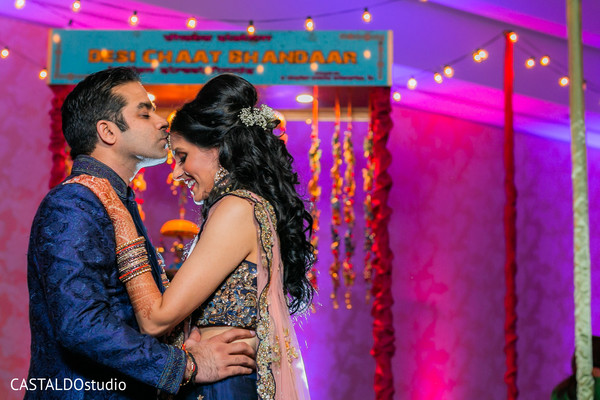 Dreamy Indian couple's sangeet photo.