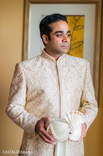 Elegant Indian groom getting ready capture.