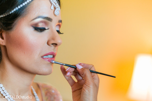 Maharani getting her lips color.