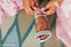 Indian bridal getting her anklet on.