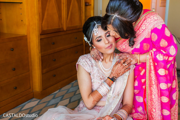 Indian bride's mother sweet moment capture.