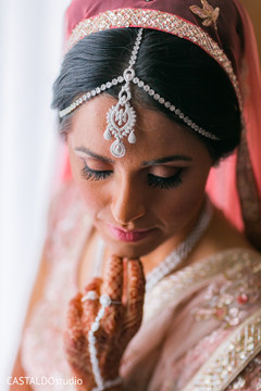 Indian bride posing with her matha patti.