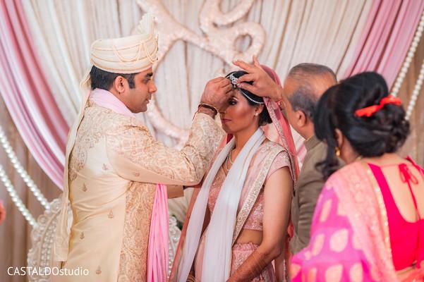 Indian bride and groom at the Malgasutra ritual.