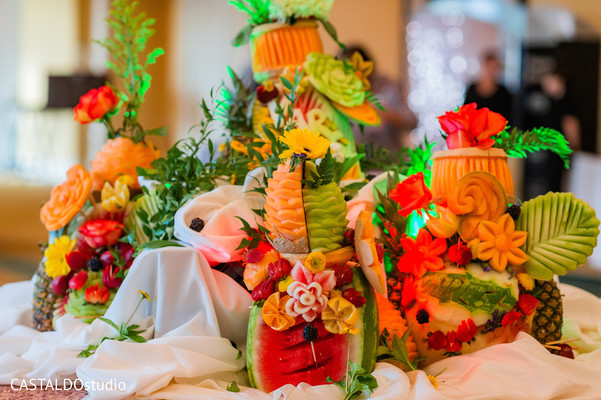 Magnificent Indian wedding reception Fruits table decoration.