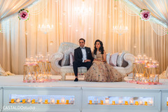 Indian bride and groom at reception party.