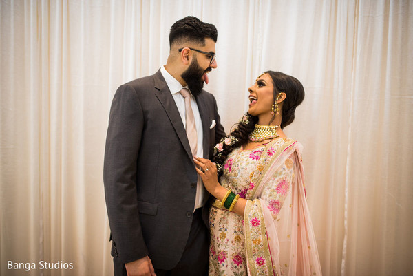 Fun capture of Indian bride and groom