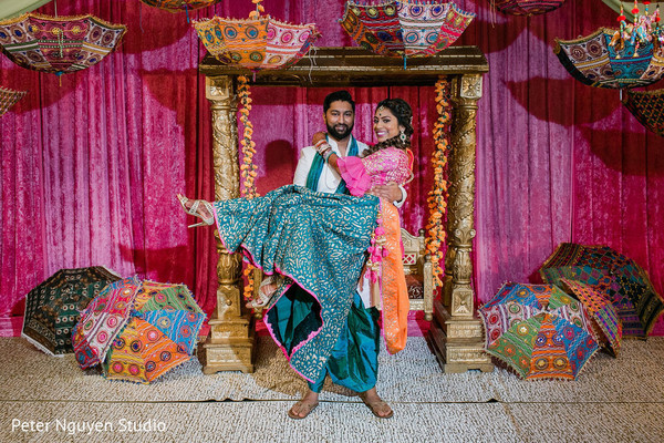 Indian groom holding the dazzling bride