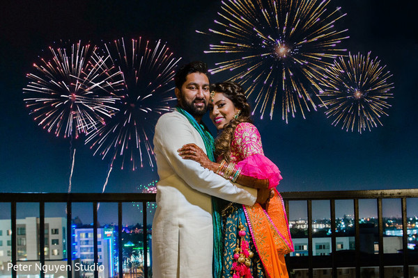 Indian couple posing with the fireworks