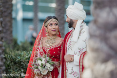 Indian bride and groom staring at each other