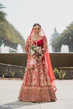 Indian bride posing outside
