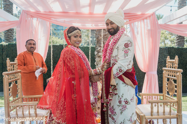 Indian bride and groom staring at the camera
