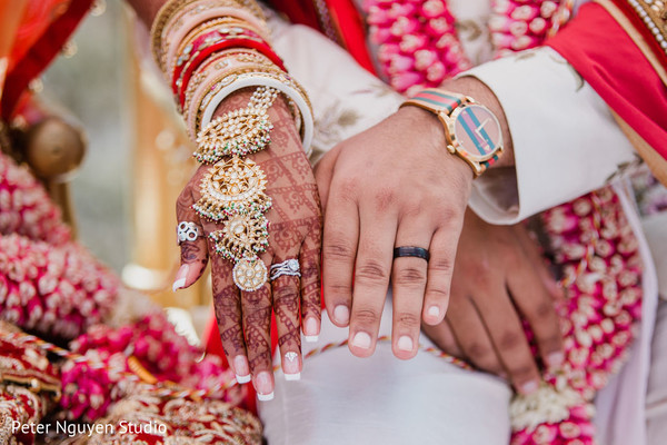 Indian couple showing their accessories and rings
