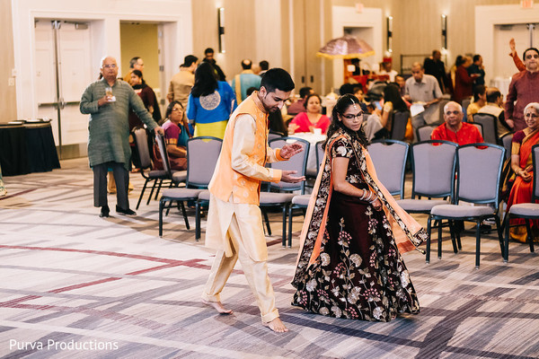 Indian couple at their sangeet dance.