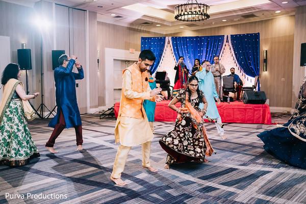 Indian bride and groom dancing at sangeet.
