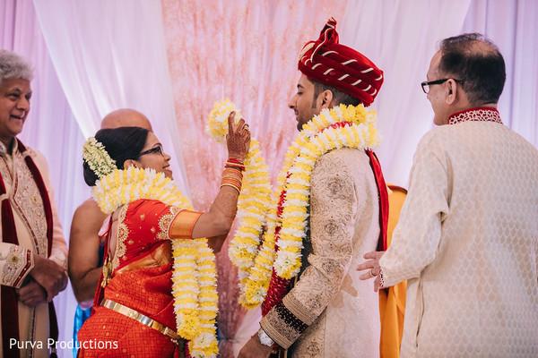Maharani Putting garland to groom.