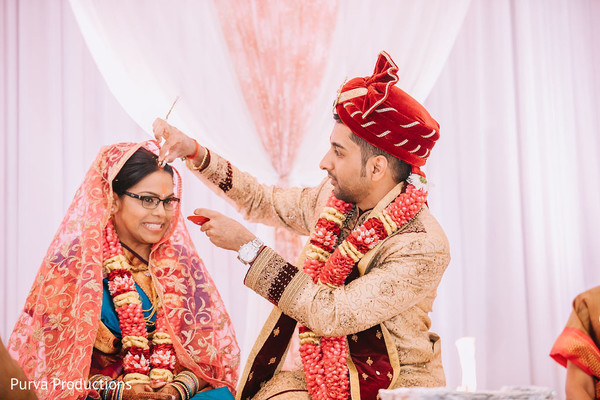 Indian groom at the Tilak ritual for bride.
