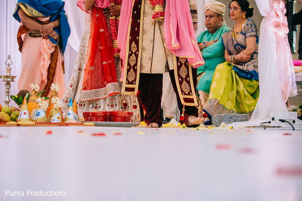 Indian groom stepping on the nuts ritual.