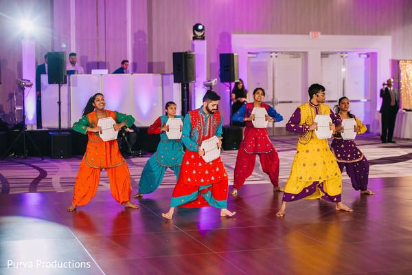 Colorful wedding Indian Bollywood dancers.