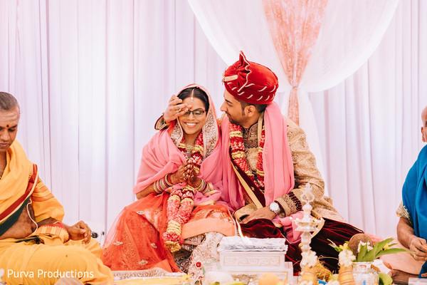 Maharani getting the tilaka dot from groom.