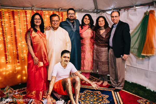 Lovely capture of indian groom with relatives at haldi.