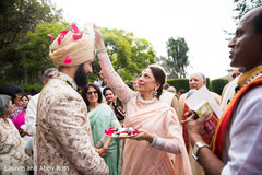 Indian groom being blessed by special guest