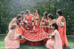 Indian bride posing with lovely bridesmaids