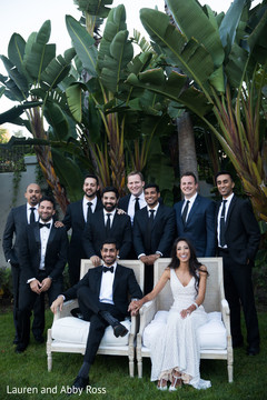 Indian groom and bride with groomsmen