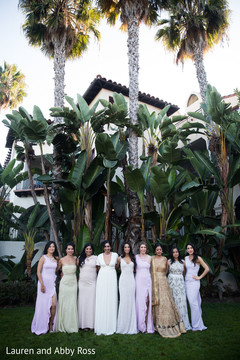 Indian bridesmaids posing with gowns